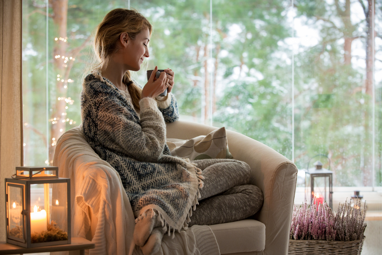 Woman relaxing and drinking tea