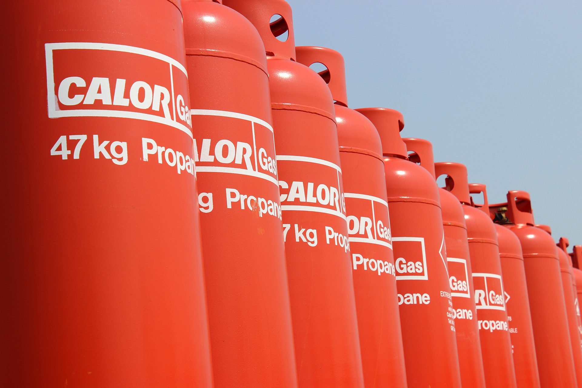 A row of 47kg propane Calor gas bottles