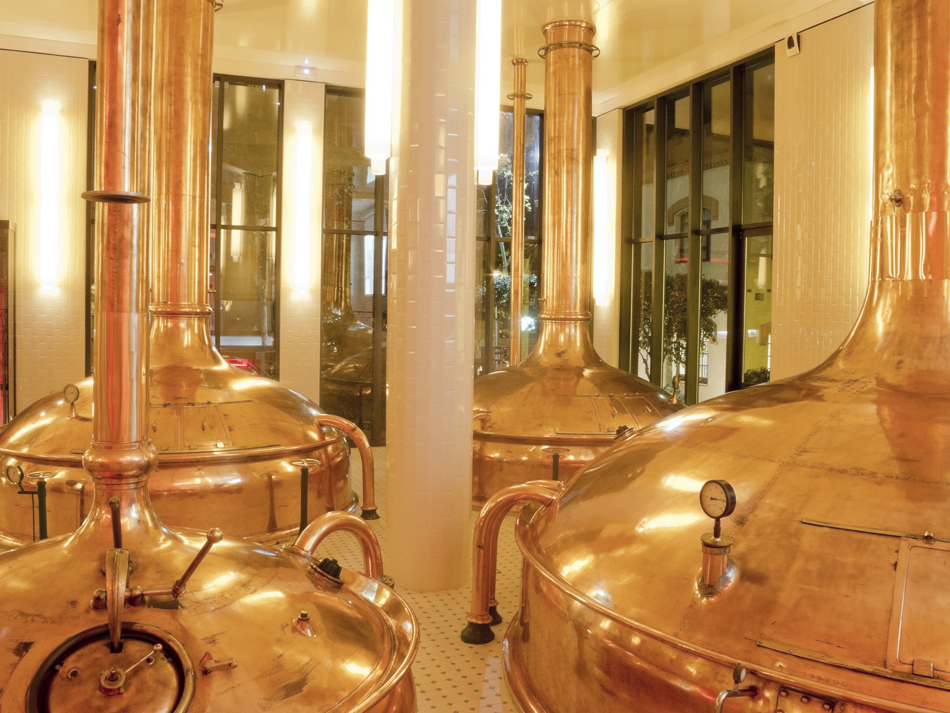 Brewery with copper distillery tanks