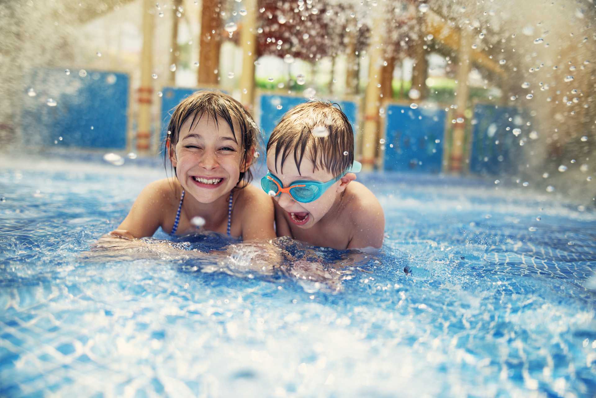 Two children laughing in a swimming pool