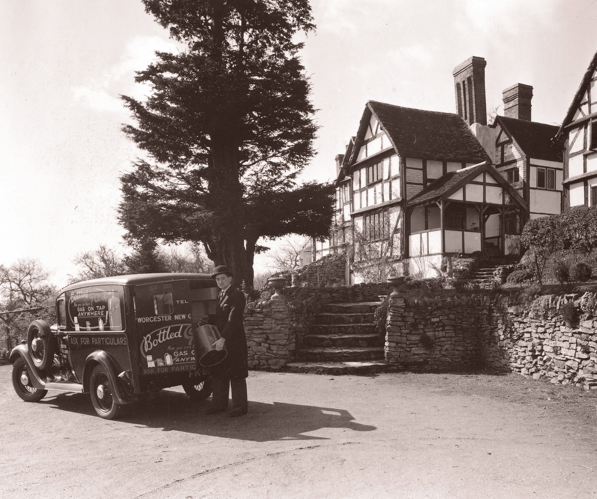 Smartly dressed Mr R.Hill delivers gas to Whitely Manor