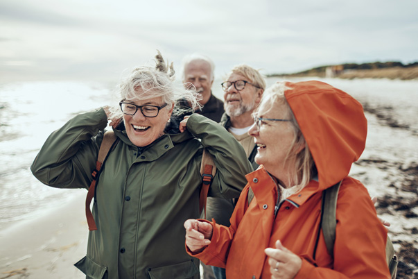 Seniors walking across a UK beach