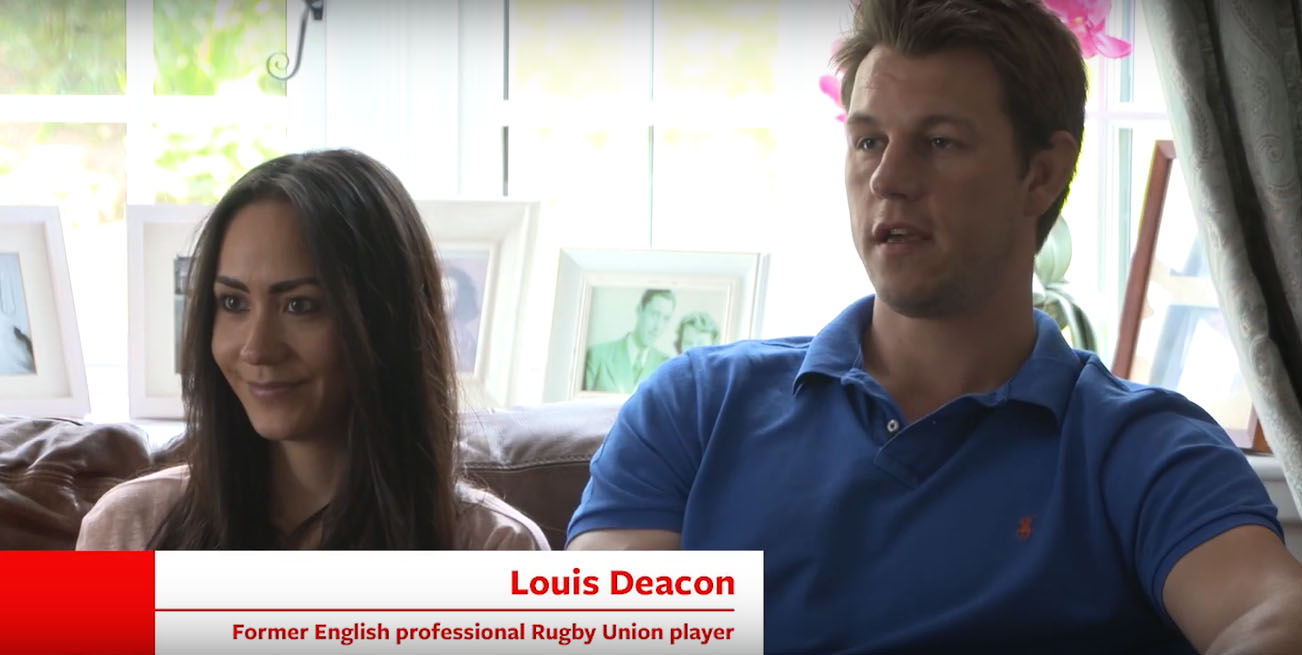Two of Calor's customers are sitting down on a sofa in their home. One of the customers is Louis Deacon, a former English professional Rugby Union player
